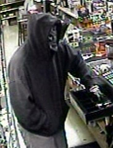 Unidentified suspect sought in liquor store robbery