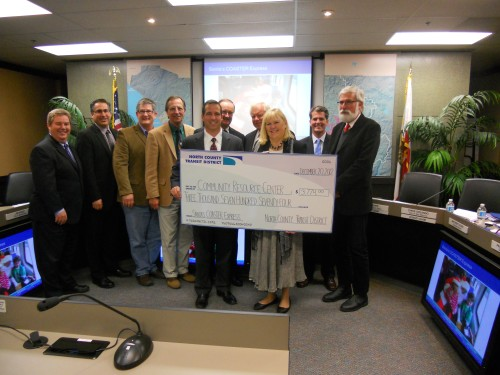 Proceeds From Santa's Coaster Express Given To Community Organizations