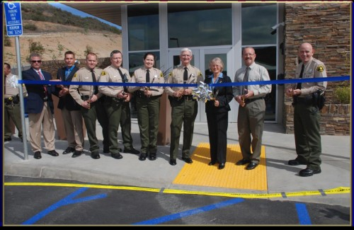 Sheriff Bill Gore, Supervisor Dianne Jacob, and county officials at