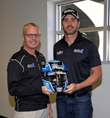 Jimmie Johnson, along with Mike Wells, president and CEO of Wells Enterprises, maker of Blue Bunny Ice Cream announced the launch of the 2014 edition of the Blue Bunny Helmet of Hope campaign.  (PRNewsFoto/Blue Bunny, Jimmie Johnson Foundation)