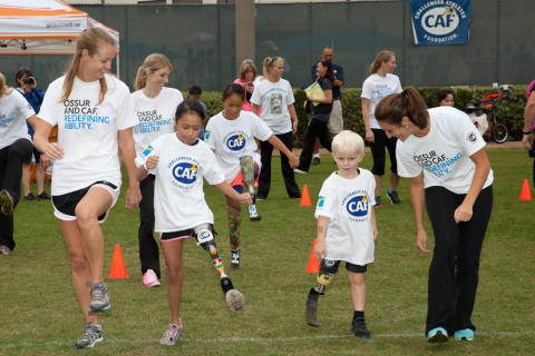 Young challenged athletes learn how to run on their new running legs provided by CAF grants. Photo: Business Wire