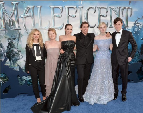 Members of the MALEFICENT cast pose for a picture at the Hollywood, CA premiere held May 28, 2014 at the El Capitan Theatre, Hollywood, CA. (Photo courtesy of Disney Studios)