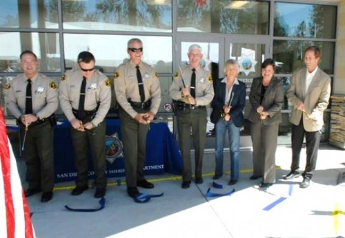 Sheriff Bill Gore, middle, and Supervisor Dianne Jacob participate in a ribbon cutting ceremony at the grand opening of the new Pine Valley Sheriff's Substation. Photo: San Diego County Sheriff's Department