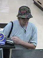 Police Search For Suspect Who Robbed U.S. Bank