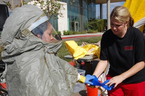 Medical staff participate in a decontamination drill.