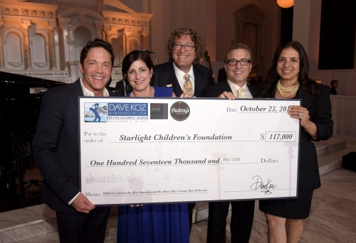 Honoree Dave Koz, honoree Roberta Koz Wilson (Audrey's Cookies Founder & CEO), Starlight Children's Foundation Global Board Chair Roger Shiffman, music producer Jeff Koz and Starlight CEO Jacquie Hart present the check to Starlight at the 2014 Starlight Awards at Vibiana on October 23, 2014 in Los Angeles, California. (Photo by Jason Kempin/Getty Images for Starlight Children's Foundation)
