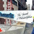 Crews remove Philadelphia International Records sign.