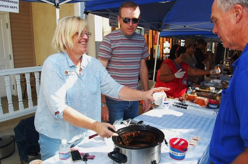Oceanside city employee Margery Pierce serves chili to visitors at the annual Heritage Park Fall Festival. Photo: Gina Yarbrough/San Diego County News