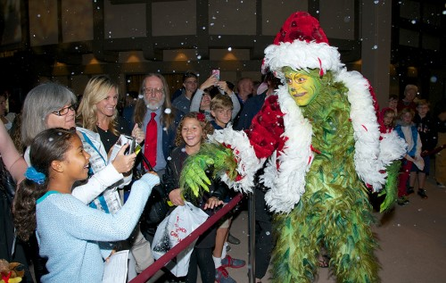 The Grinch (Burke Moses) greets audience members at The Old Globe ninth annual Christmas Tree Lighting on Nov. 16 featuring performances by the cast of Dr. Seuss How the Grinch Stole Christmas!, the lighting of the Seuss-inspired Christmas tree, and a delightful holiday snowfall. Photo by Bob Ross.