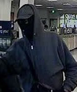 Law enforcement agencies search for unidentified bank robber.