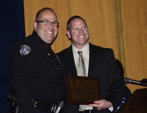 Escondido Police Officer Juan Alva receives Officer of the Year from Lieutenant Jason Penner. Photo: Gina Yarbrough/San Diego County News