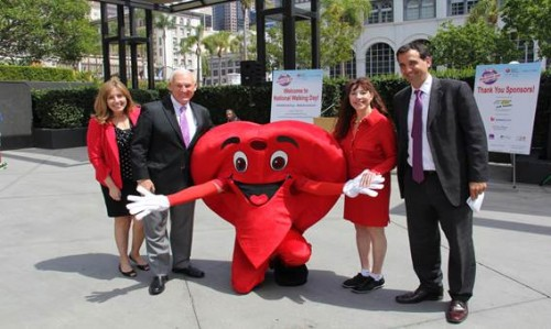 """L to R: American Heart Association San Diego Division Executive Director Jennifer Sobotka, San Diego County Supervisor Ron Roberts, Union Bank Vice President Rana Sampson, American Heart Association San Diego Division Board Chair David S. Demian, along with American Heart Association's mascot """"Ticker,"""" kick off the National Walking Day celebration on April 1 at Horton Square."""