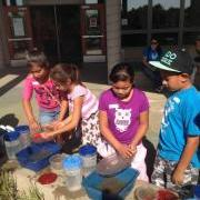 Students pair in teams and are challenged to conserve water in a dish washing activity. Courtesy photo