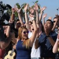 """Contestants cheer as """"American Idol"""" videotapes a segment for the show. Photo: Gina Yarbrough/San Diego County News"""
