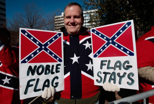 COLUMBIA, SC - JANUARY 21:  Dr. John Cobin of Greenville, South Carolina displays signs in support of displaying the Confederate flag at a Martin Luther King Day rally January 21, 2008 in Columbia, South Carolina.  Cobin is a member of the League of the South, a Southern nationalist organization.  All three major Democratic candidates for President spoke to a large crowd on the state house grounds.  (Photo by Chris Hondros/Getty Images)