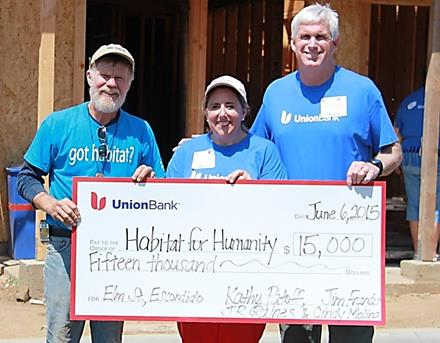 (L - R): Joe Carton, Senior Construction Superintendent, Habitat for Humanity, accepts a $15,000 donation from Union Bank Vice President, Employee Engagement Leader Cindy Molina and Managing Director and Head of Consumer Lending Jim Francis. The bank's Consumer Lending Division contributed more than 400 volunteer hours to build houses in the new Elm Street Community in Escondido.