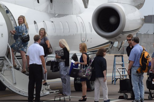 Passengers board the BizAir Shuttle to Las Vegas. Photo: Gina Yarbrough/San