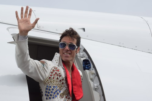 An Elvis impersonator boards the BizAir Shuttle to Las Vegas. Photo: Gina Yarbrough/San Diego County News