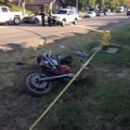 Motorcycle lies on the road after