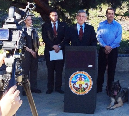 Cutline: Supervisor Dave Roberts addresses reporters during a Monday news conference at Rancho Coastal Humane Society in Encinitas. Also shown (from left) are Lt. Kalani Hudson, Department of Animal Services; Stephen Rea, Office of Emergency Services; Jim Silveira, Rancho Coastal Humane Society, and his dog, Gunner.