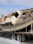 Boat Washed Up On Moonlight Beach Towed